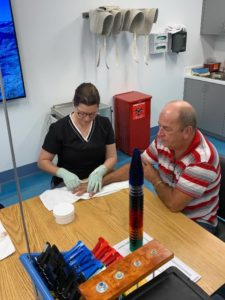Miami Hand Center staff assisting patient therapy wide angle